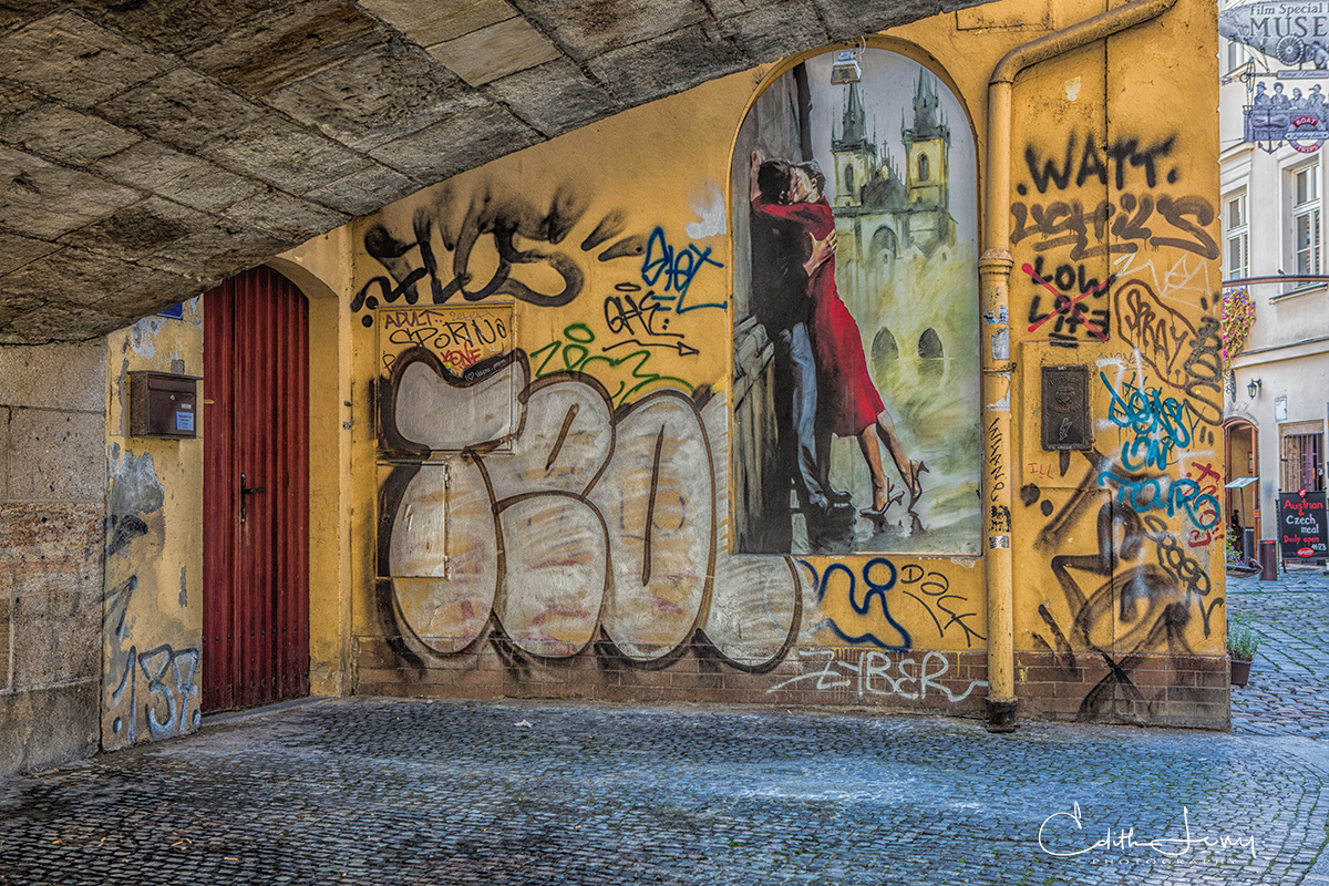 Street art and graffiti in a small alley in the old city of Prague.