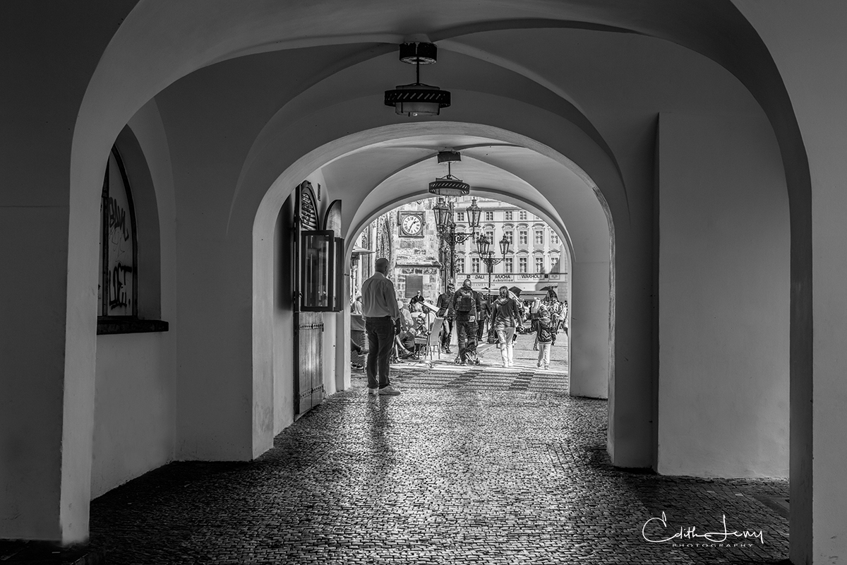 A walkway through the old city is punctuated by architectural details of beautiful arches.