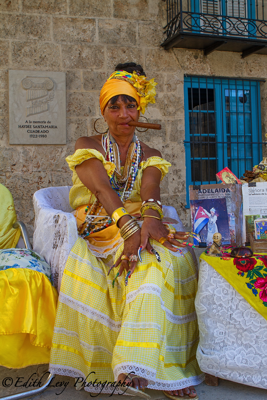 Cuban Woman in Traditional dress with Cigar