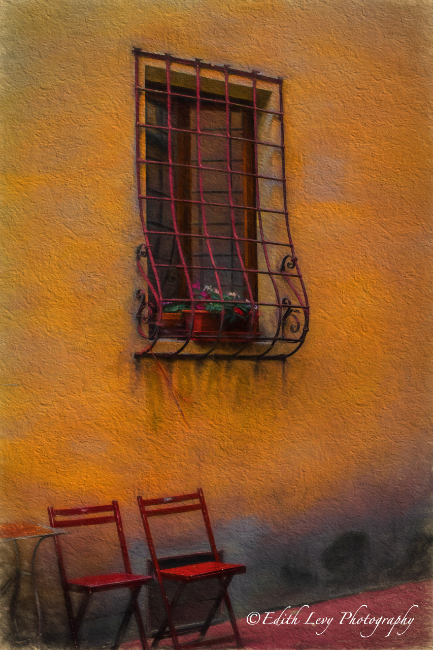 Chairs outside a building in Tuscany