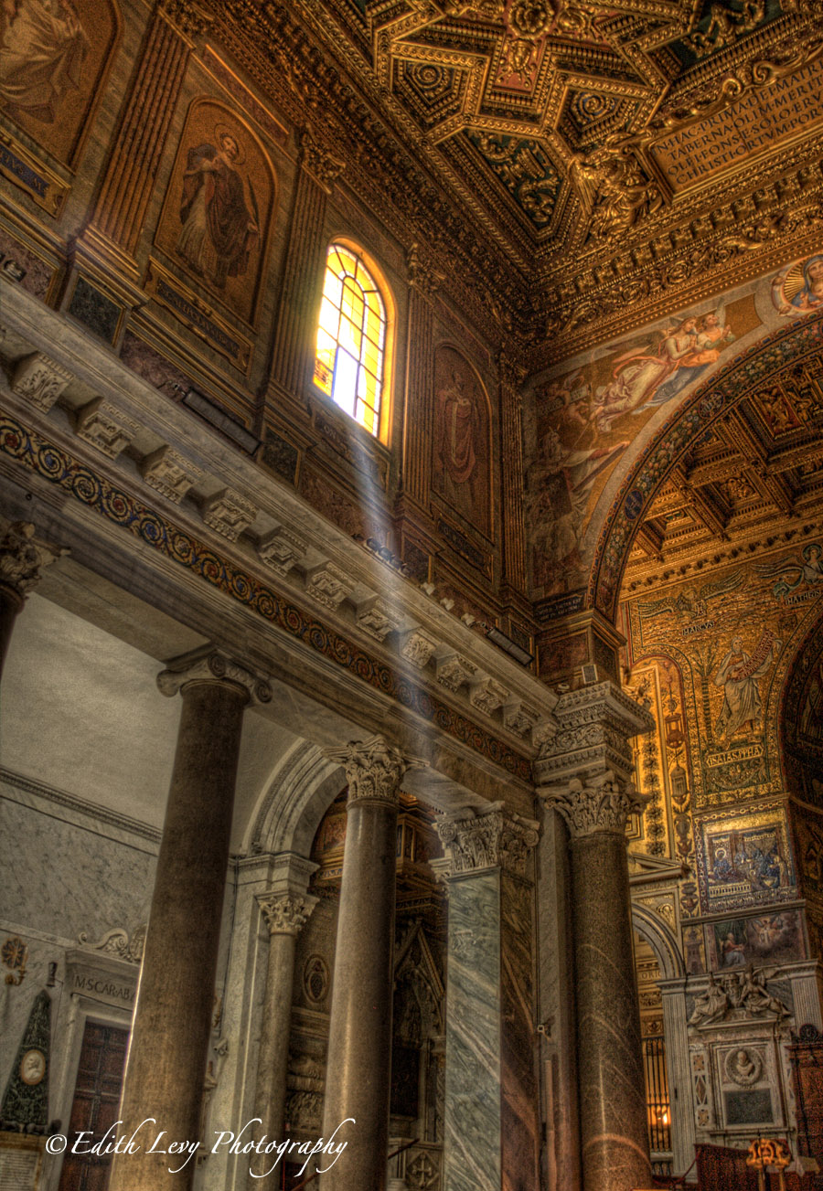 The Church of Santa Maria located across the river in Trastevere.