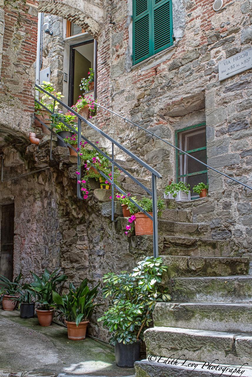 A beautiful stone staircase leading to a private home in Corniglia in Cinque Terre.