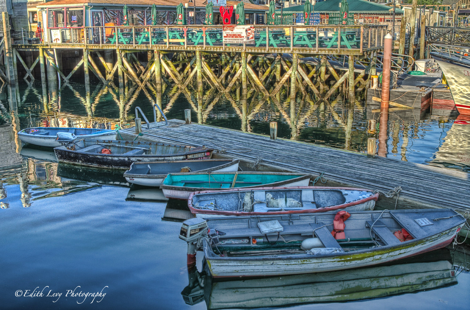 Colourful row boats in the calm morning waters in Bar Harbour.