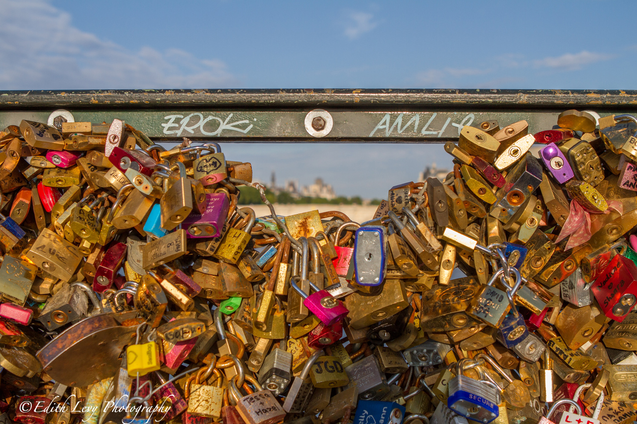 People attach love locks to the Pont des Arts bridge in Paris and then throw the key into the rive Seine as a romantic gesture...