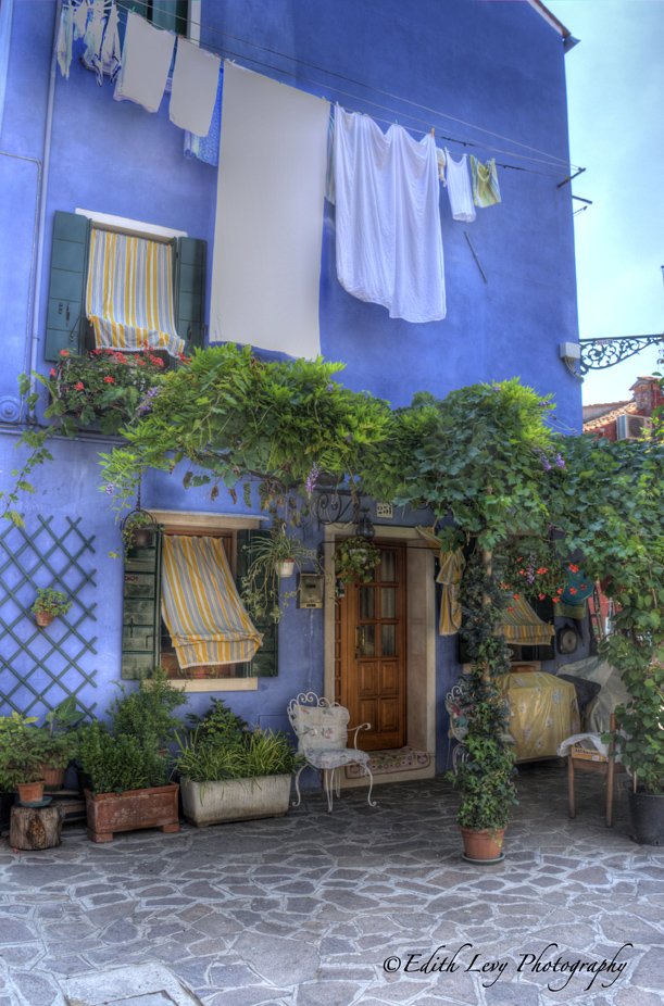 Even the laundry looks good against the blue building in Burano.