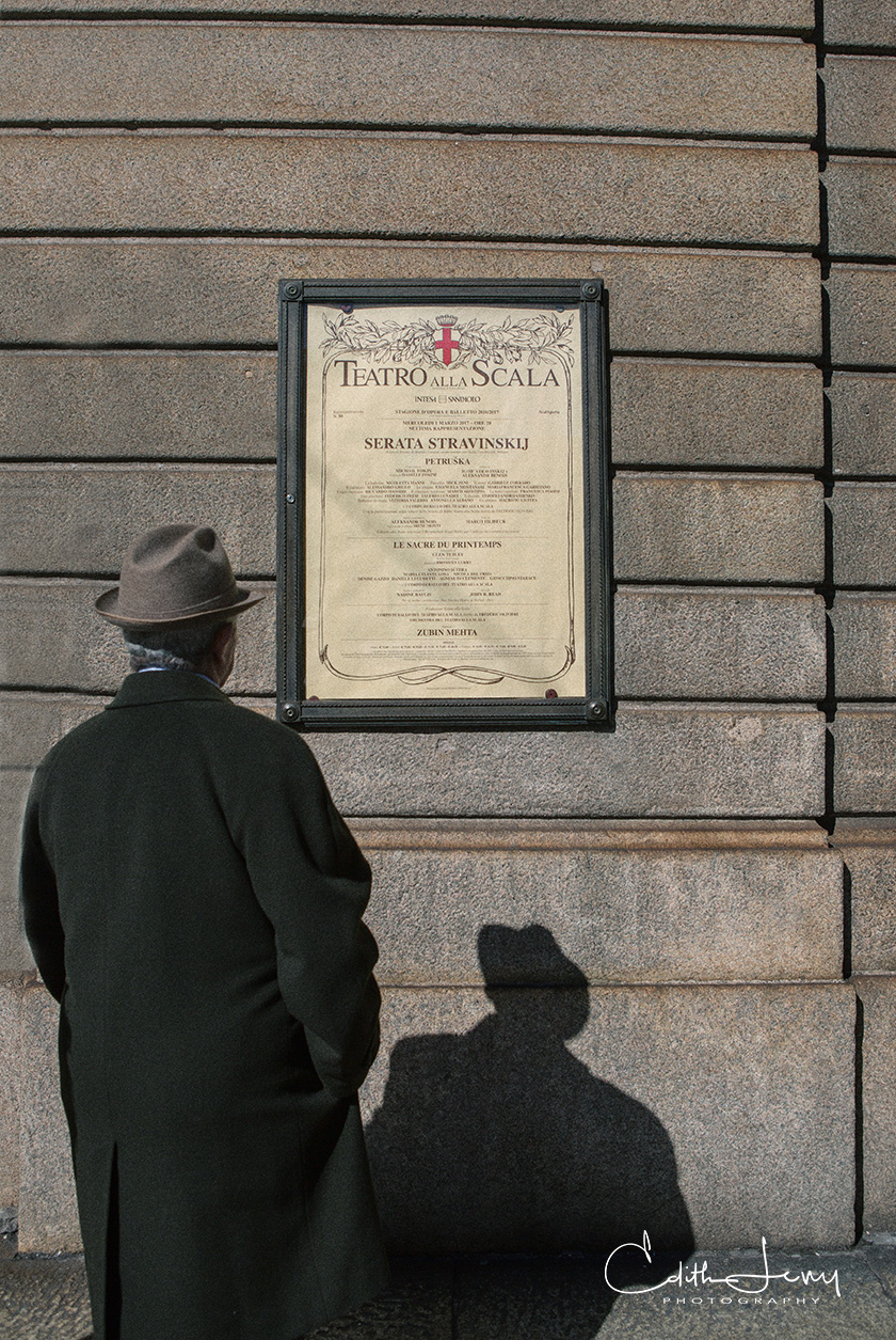 A man stops to see what's on at the La Scala Theatre