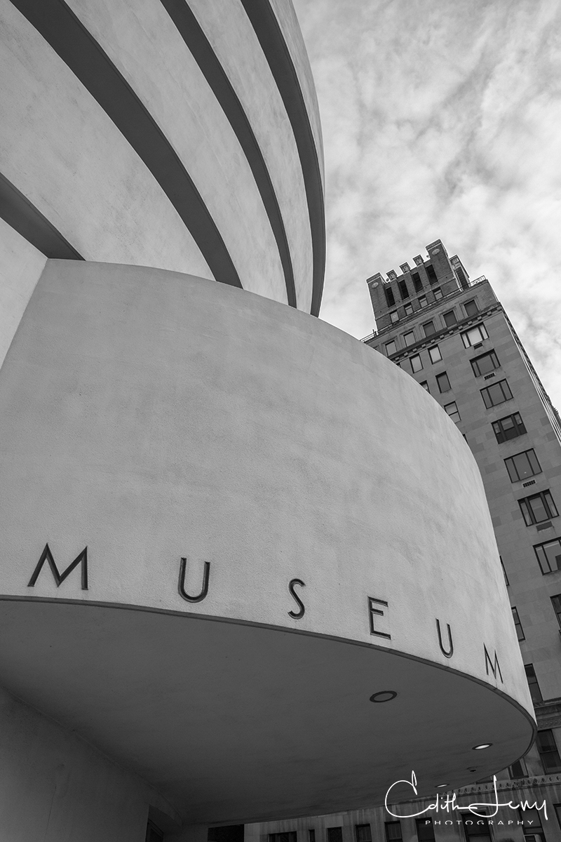 The exterior curves and beautiful architecture of the Guggenheim Museum.