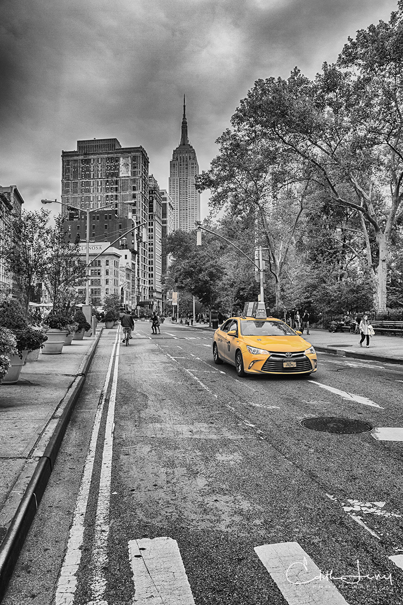 A classic taxi in lower Manhattan with the Empire State Building as the backdrop.