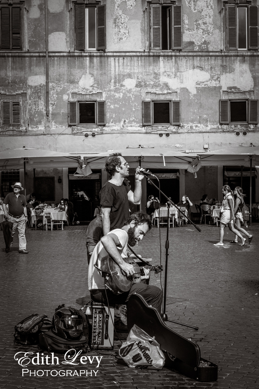 Street musicians entertain the tourists in the a square in Trastevere.
