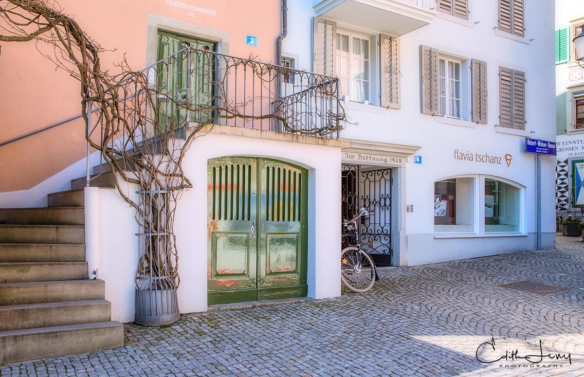 Peach coloured building, green doors....