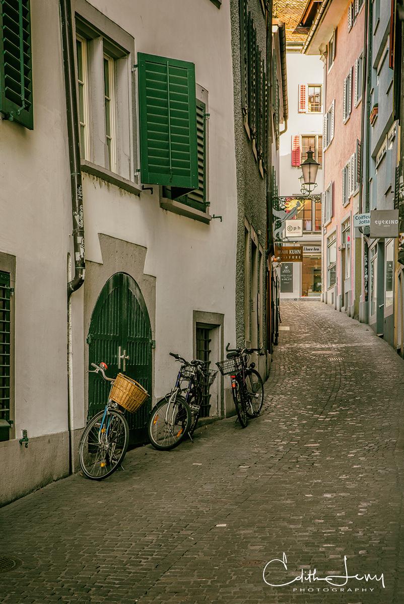 Zurich, Switzerland, city, bicycles, cobblestone, alley, curved alleyway