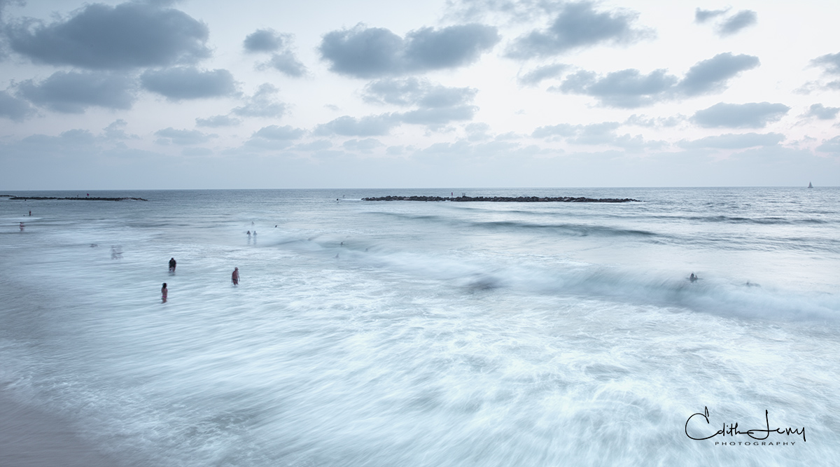 Limited Edition of 50 As the sun gets ready to set on Tel Aviv, sunbathers go in for one more swim.